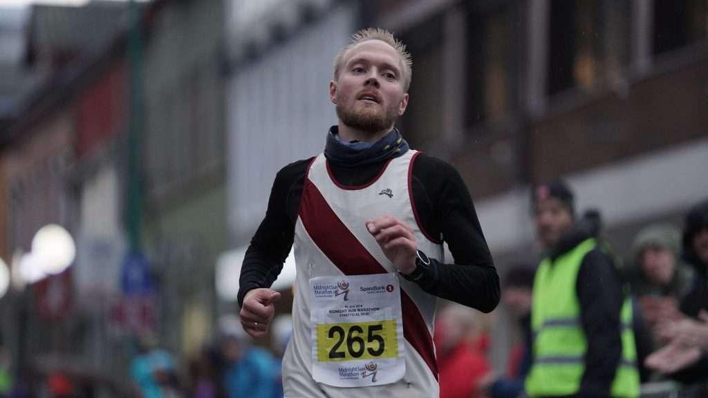 Runner at finish line at Midnight Sun Marathon 2018