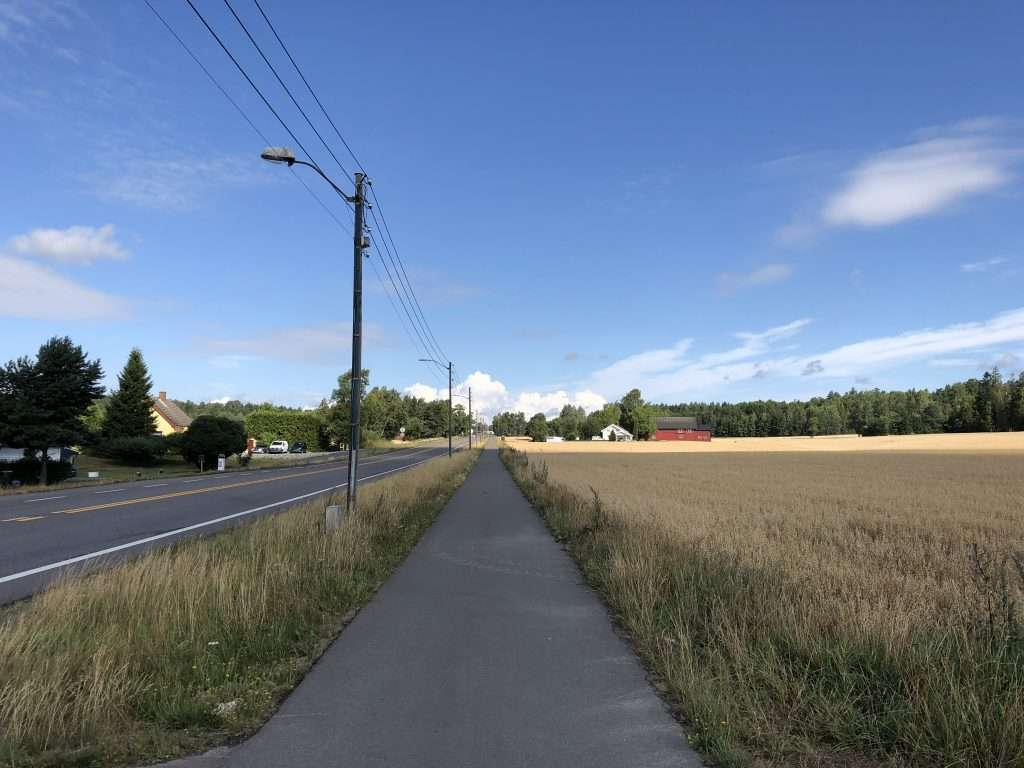 Paved sidewalk perfect for running in Ski, Akershus, Norway.